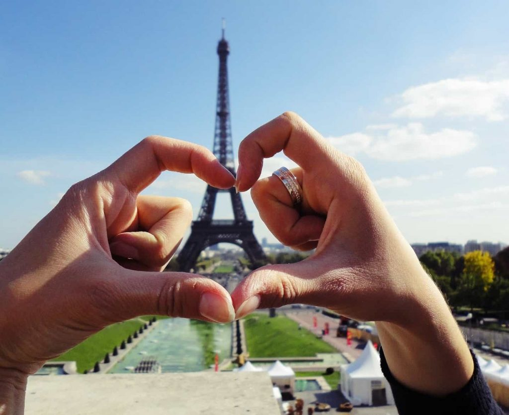 Love hands with the Eiffel Tower in the background.