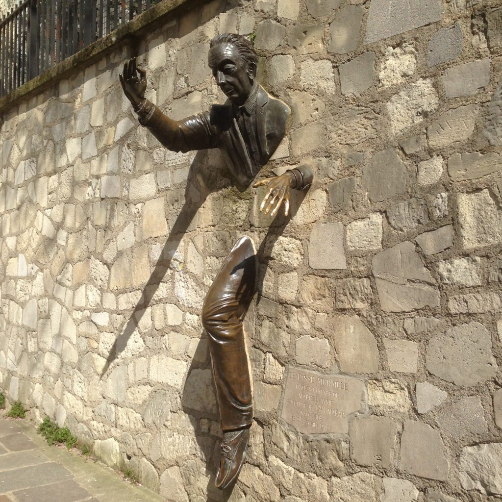 A photo of the Passer Through Walls Statue in Montmartre, Paris