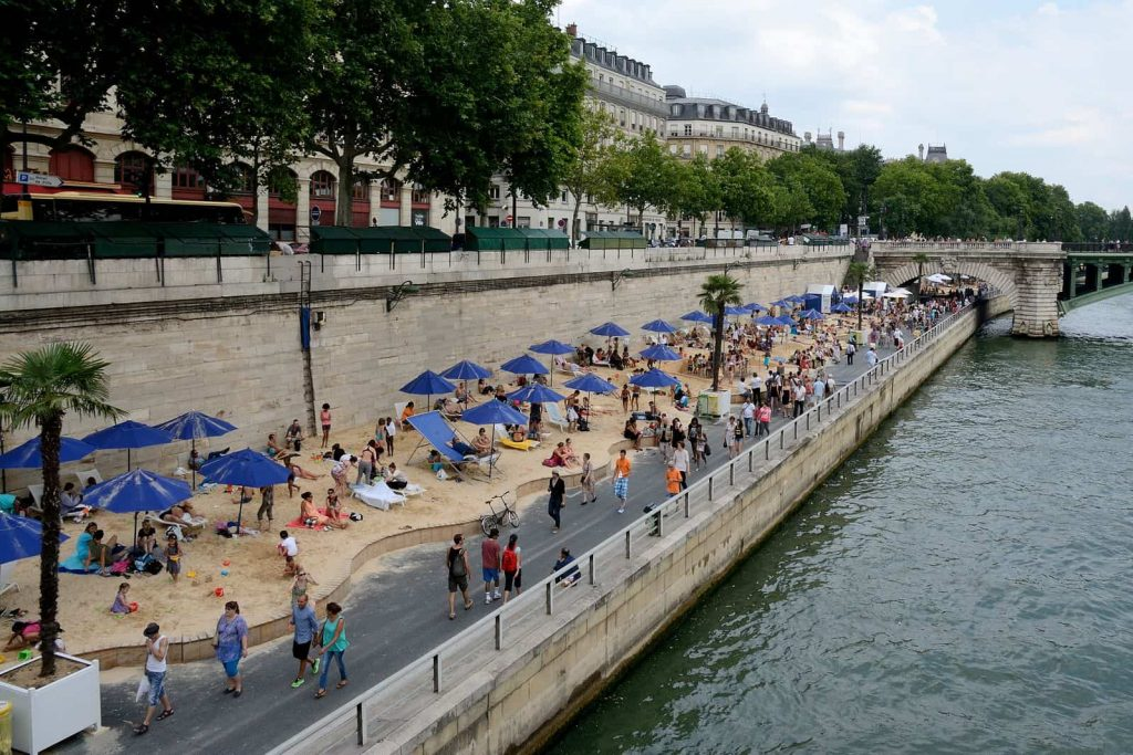 A photo of the Paris Plages, an artificial beachfront created along the Seine every summer.