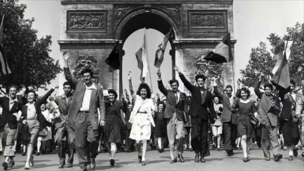 A photo of Parisians marching under the Arc de Triumph during the Liberation of Paris