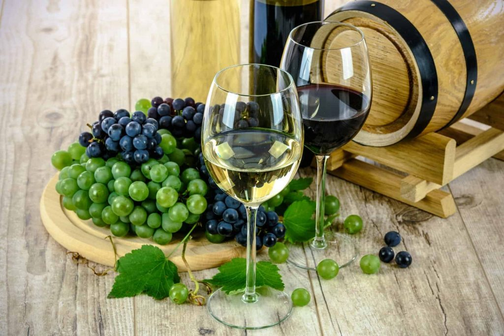 A photo of wine and grapes, which is one of the main reasons to visit France this year.