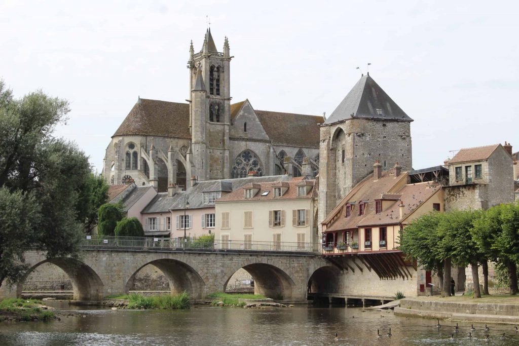 A photo of Notre Dame and the river in Moret-sur-Loing.
