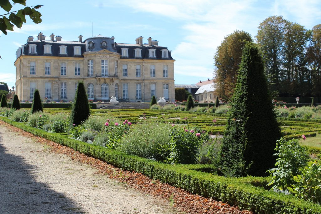 A photo looking back up at the chateau from the gardens at the Château de Champs-sur-Marne.