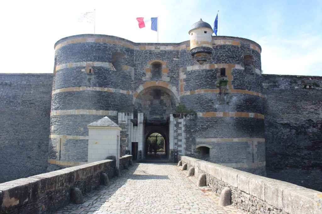 A photo of the front facade of the entrance to the Angers chateau.