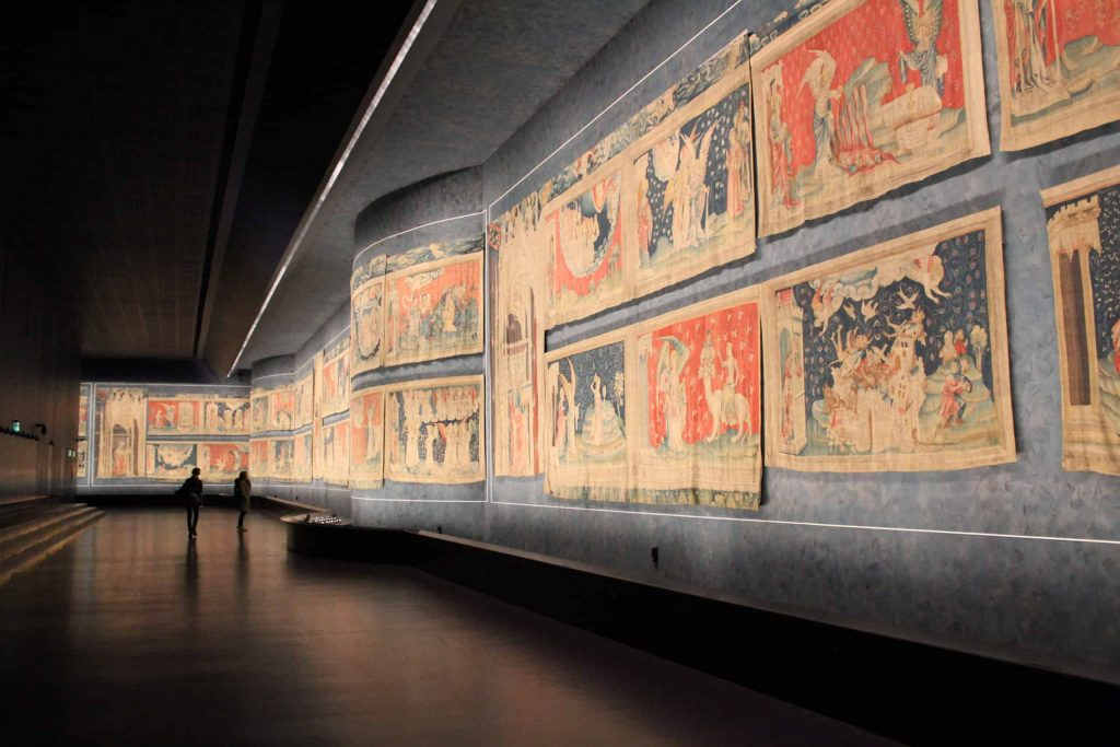A photo of the length of one of the galleries of the Apocalypse Tapestry.