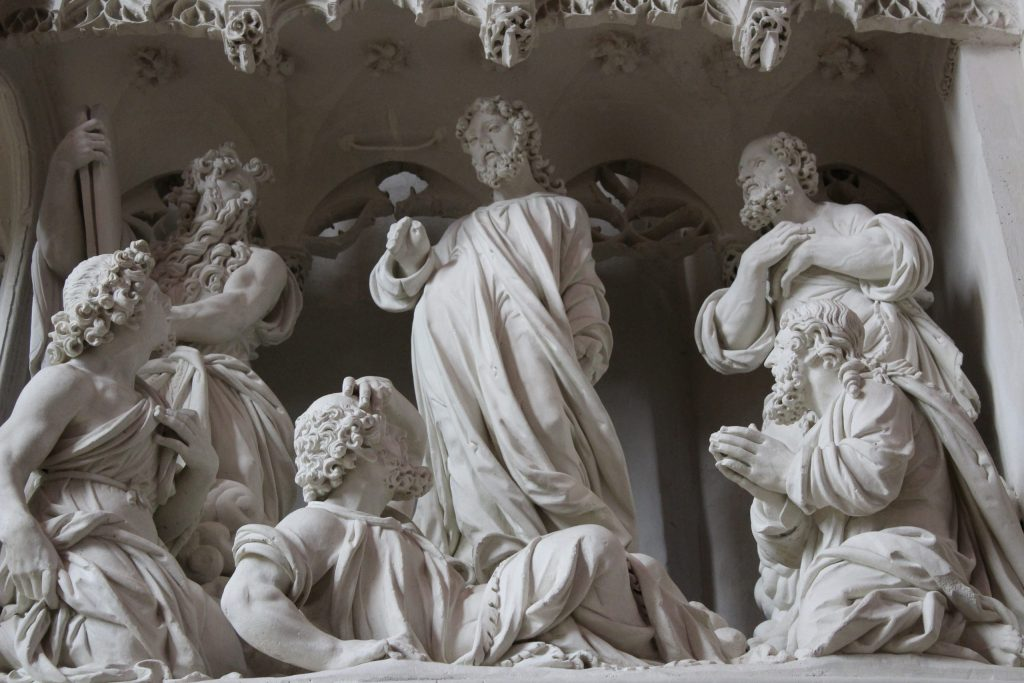 A photo of a sculpted scene of the choir wall of the Chartres Cathedral.