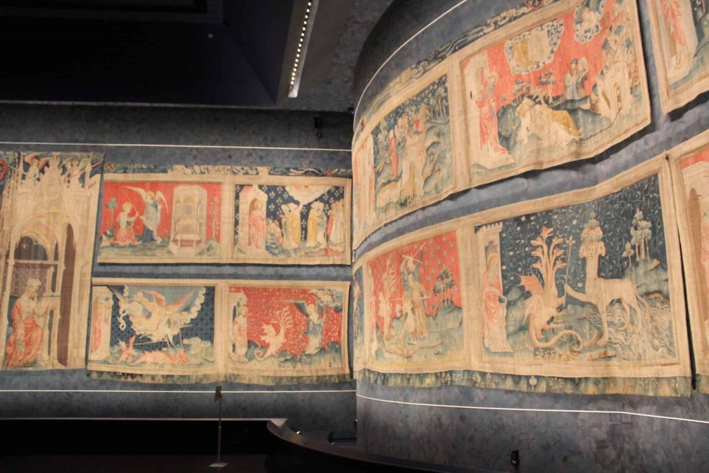 A photo of the corner of the L shaped gallery of the Apocalypse Tapestry.