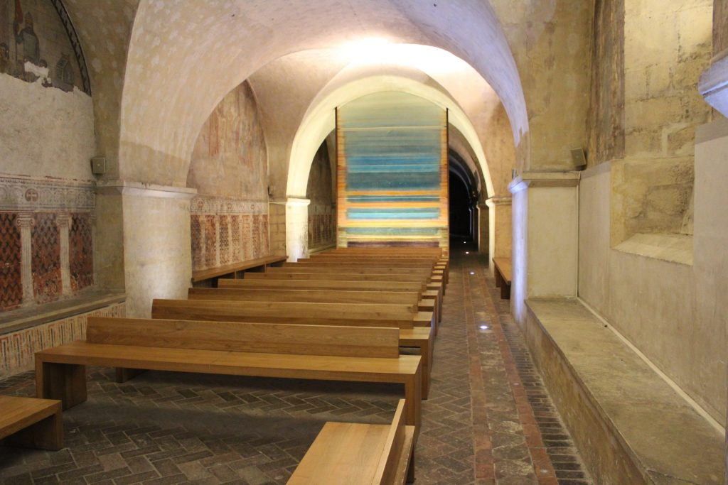 A photo of the Curtain of Light art installation in the crypt of the Chartres Cathedral.