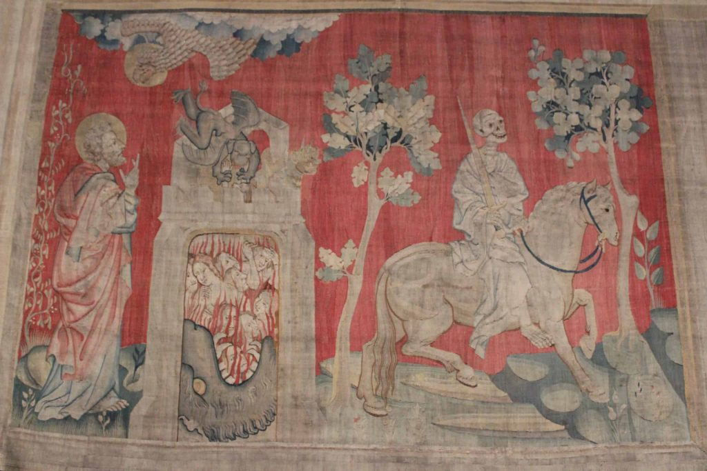 A close up photo of one of the panels of the Apocalypse Tapestry that depicts the Horseman of Death.