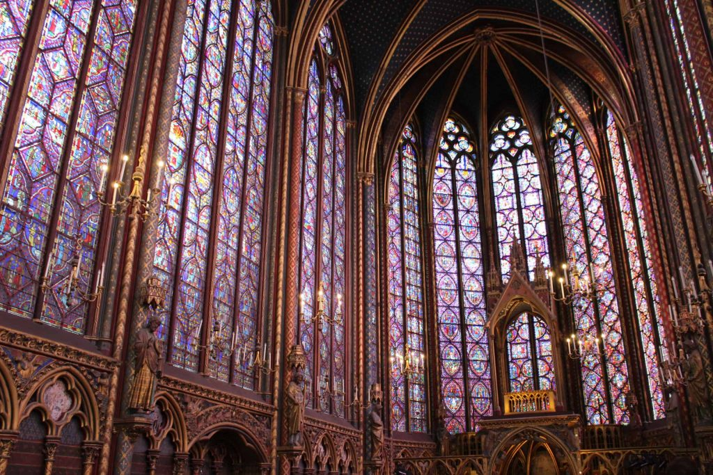A photo of the nave of Sainte-Chapelle, taken from the side to show off more of the windows.