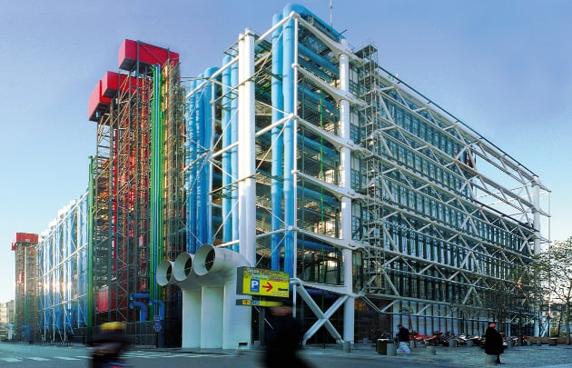 A photo of the back of the Centre Pompidou, showing the multi-coloured pipes running along the outside of the building.