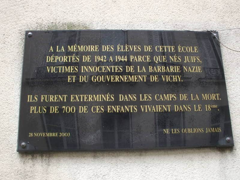 A photo of a plaque commemorating the Jewish students who were exported to concentration camps during WWII.