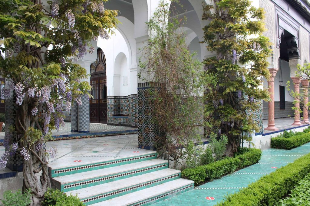 A photo of steps leading down to the main level of the gardens of the Grand Mosque of Paris.