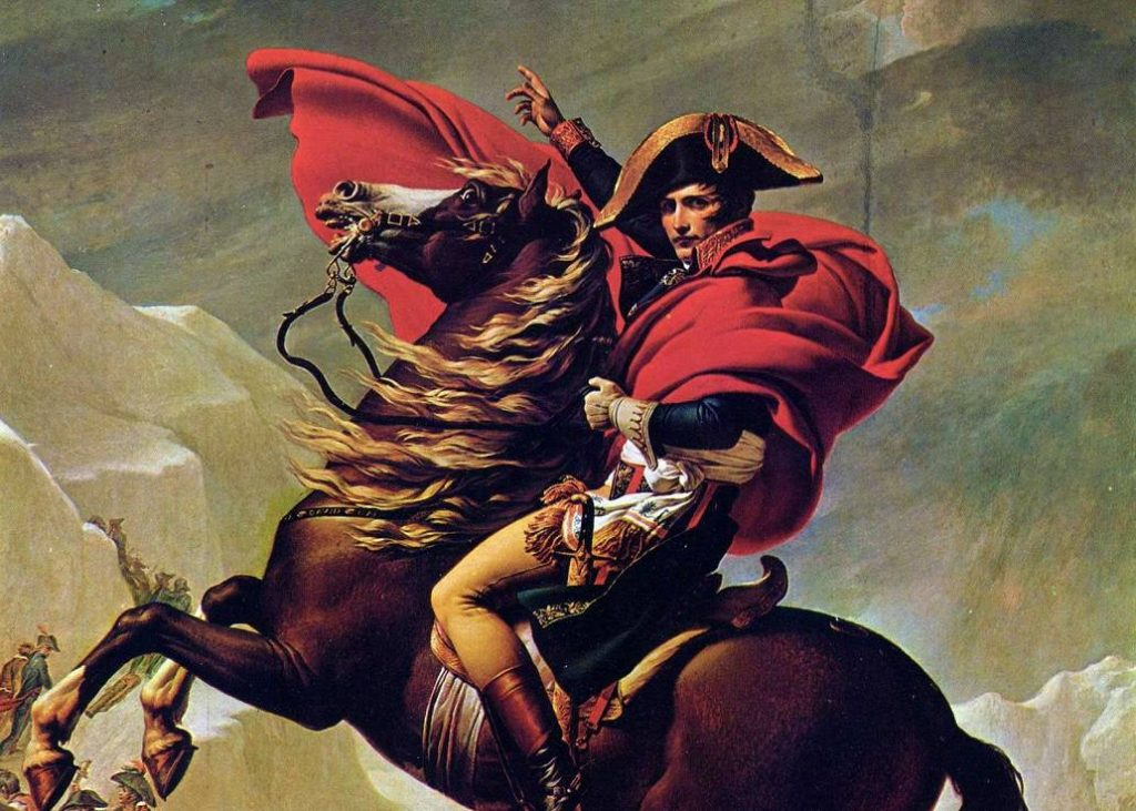 A photo of the famous painting, Napoleon Crossing the Alps, by Jacques-Louis David. Napoleon is on a horse that is reared up, looking directly at the viewer, with his hand raised up.