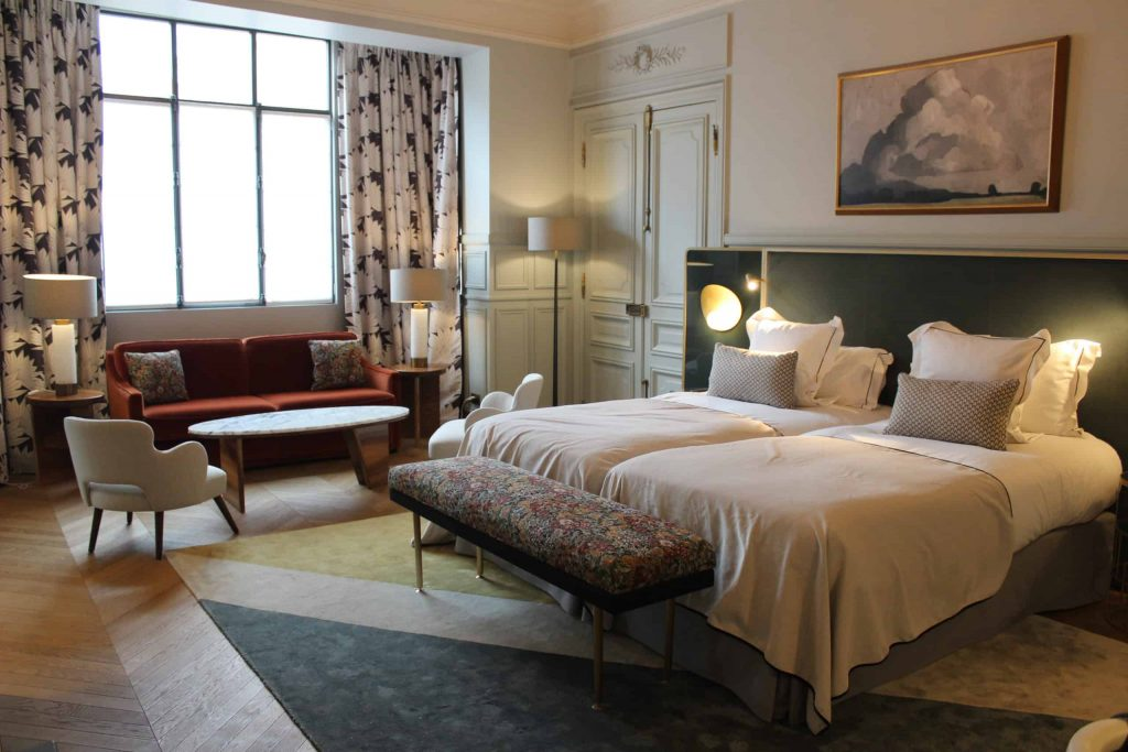 A photo of the beds and living room area of our room at the Grand Powers Hotel.
