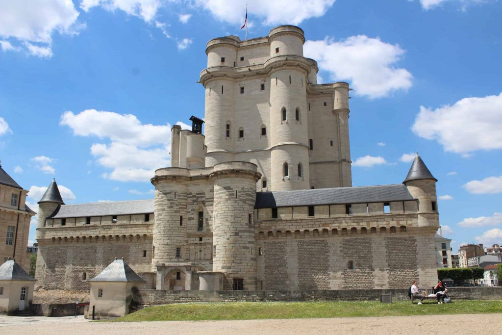 A photo of the exterior of the Chateau de Vincennes, including the towers of the keep.
