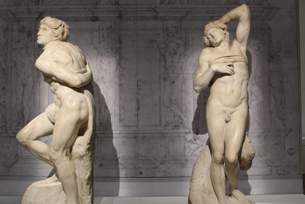 A photo of Rebellious Slave and Dying Slave by Michelangelo, some of the extraordinary arts and culture in Paris.