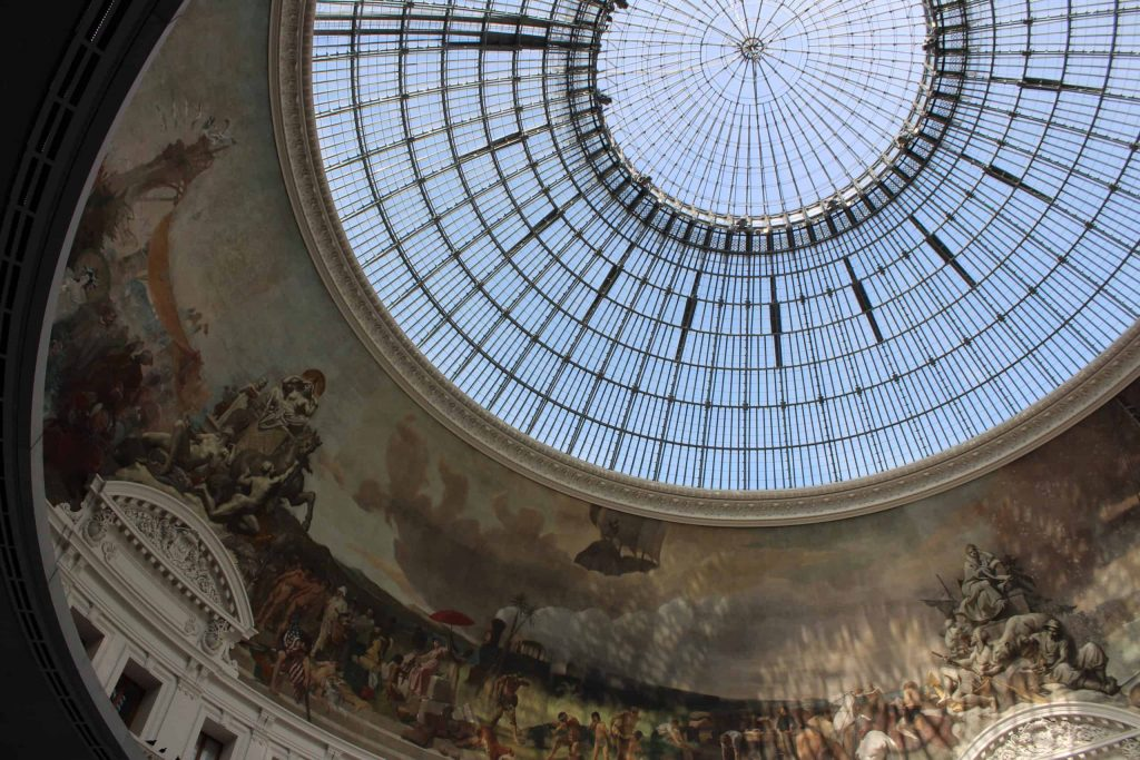 A photo of the metal dome cupola that makes up the roof of the Bourse de Commerce.