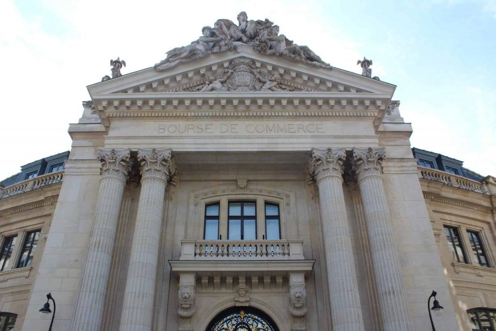 A photo of the front facade of the Bourse de Commerce.